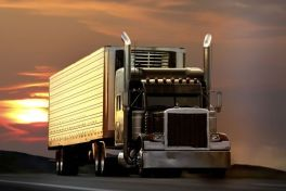 Truck driving down the road in the sunset , T.G. Stegall Truck Co.
